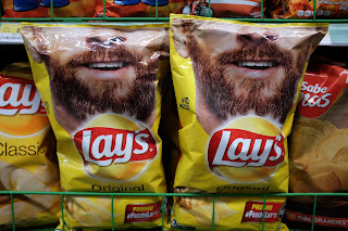 Lays chips with bearded man on front in Puriscal