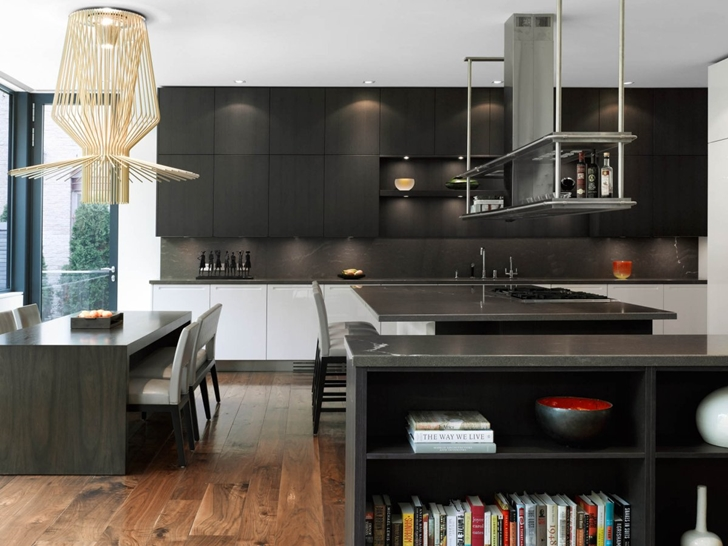 Black kitchen in Modern mansion by Belzberg Architects Group
