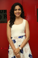Actress Ritu Varma Stills in White Floral Short Dress at Kesava Movie Success Meet .COM 0043.JPG