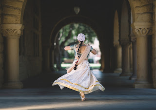 new dehili woman dancing with flowing dress on