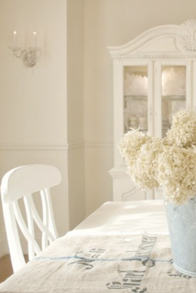 French farmhouse white dining room with Nordic French decor by Hello Lovely Studio