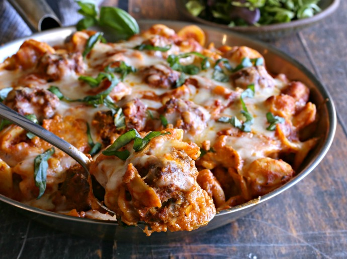 Casserole of meatballs, pasta, marinara sauce and cheese.