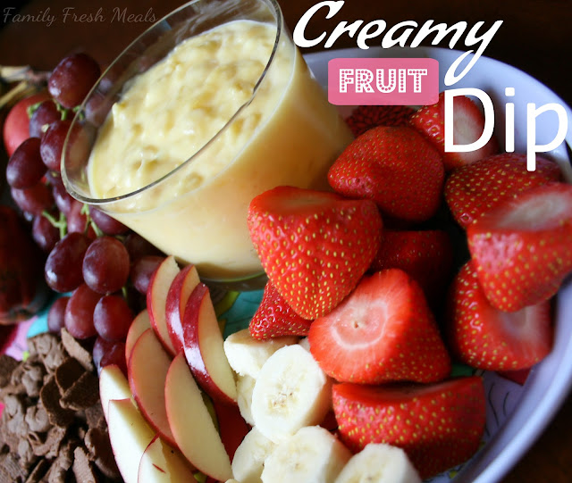 Pineapple Fruit Dip served with strawberries, bananas, sliced apples, grapes and chocolate crackers