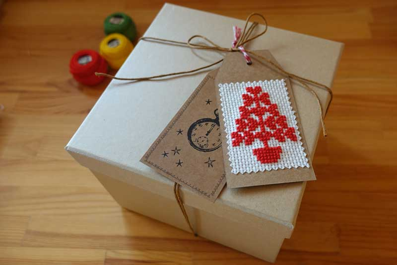 cross stitch gift tag is finished