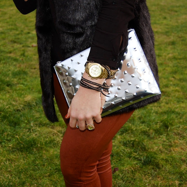 Ela Editor's Pouch clutch, Michael Kors gold watch and an Alden Rae bracelet