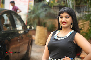Actress Model Poorni Stills in Floral Long Dress at Silk India Expo Launch  0032.JPG
