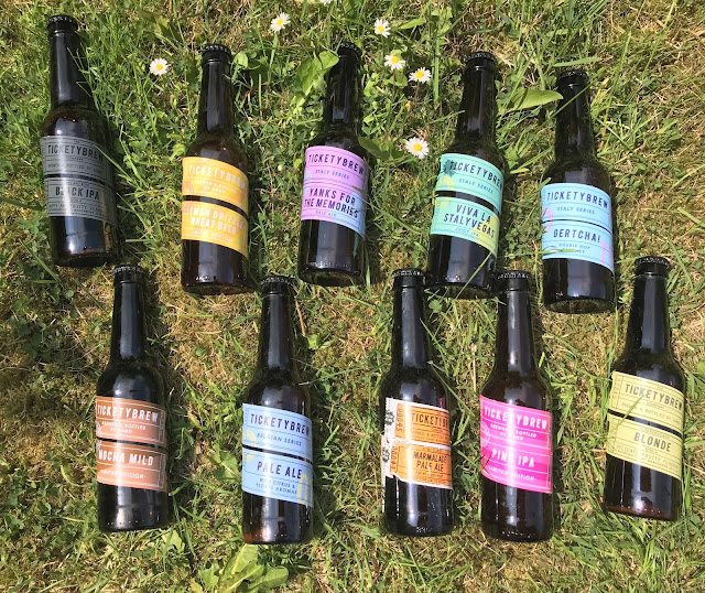 10 bottled of craft beers unopened on lawn