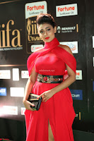 Apoorva in a Stunning Tight Leg Split Sleeveless Red Gown at IIFA Utsavam Awards 72.JPG