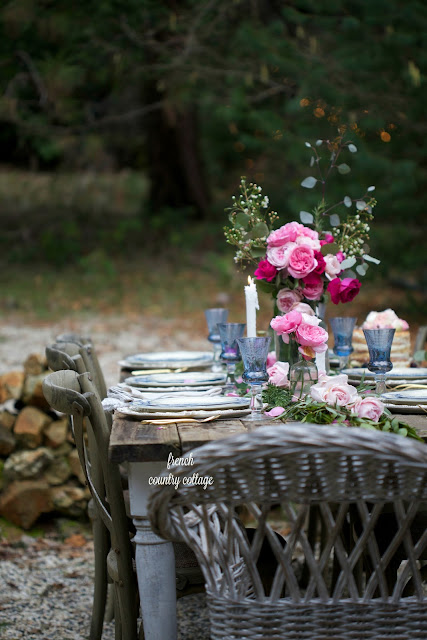 Flowers on a romantic inspired table setting outdoors with ambiance