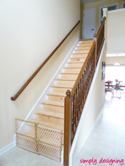 photo of full staircase with paint sanded off the stair risers to ready for staining during our staircase redo