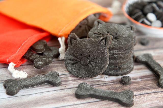 Homemade Halloween dog treats shaped like black cats and bones