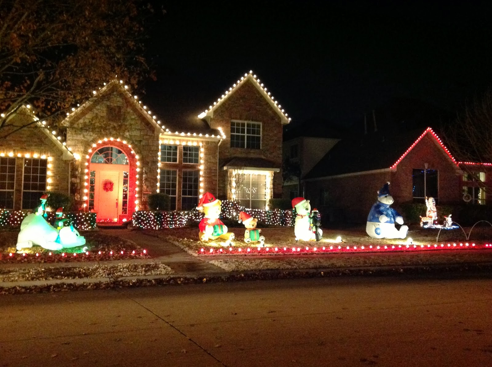 Colorful Christmas Lights On House.Family Adventures Christmas Lights