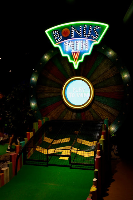 Treetop Adventure Golf's bonus 19th hole, lit up with bright lights