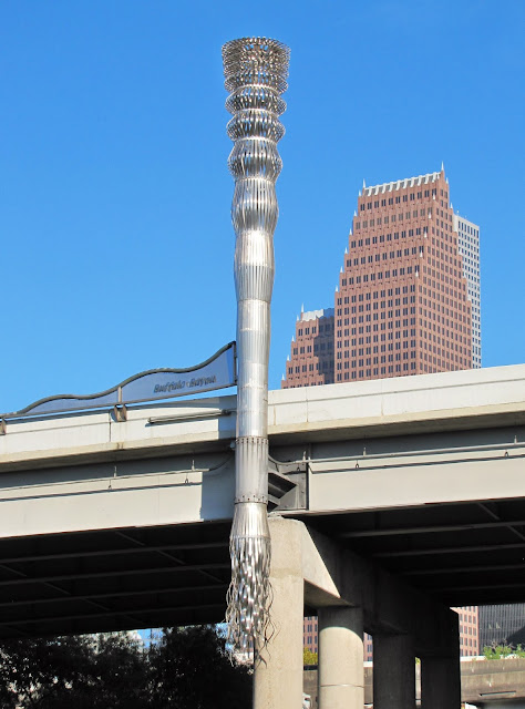 Buffalo Bayou Torch with Bank of American Center as background