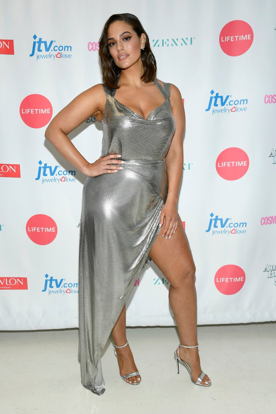 a12444f3a Ashley Graham turns up the heat in low cut dress in NYC