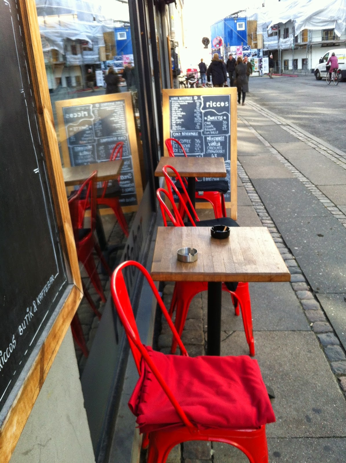 red chairs outside of Ricco's Cafe in Copenhagen