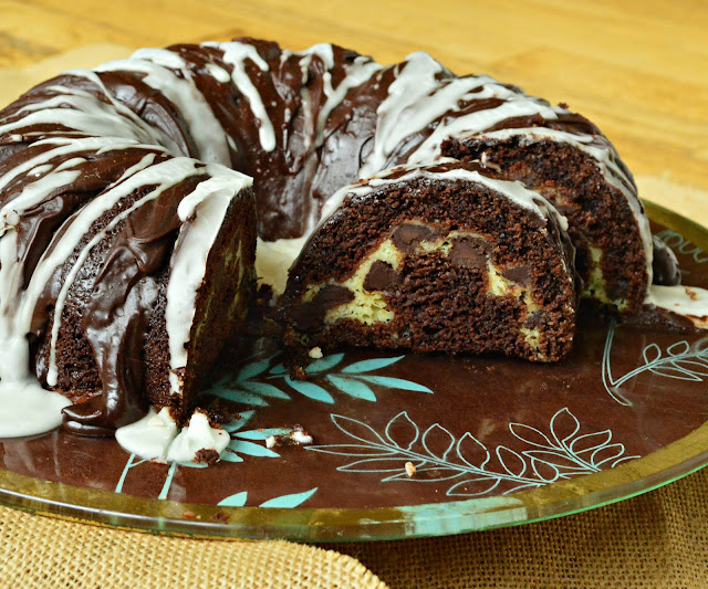 This moist and decadent chocolate bundt cake filled with cream cheese and chocolate chips is made in a flash. This is so good it has withstood the test of time! #chocolatecake #cupcakes #bundtcake #desserts #baking www.thisishowicook.com