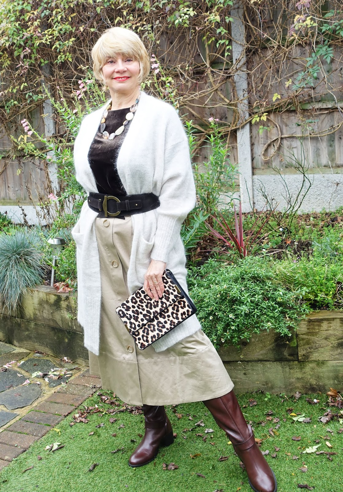 Take one beige midi summer skirt and turn it into a winter knockout featuring many of the trends of the season: cream, oat and beige colours; leopard print and long leather boots.