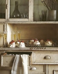 French cabinets, desserts and champagne make this kitchen setting look style magazine ready