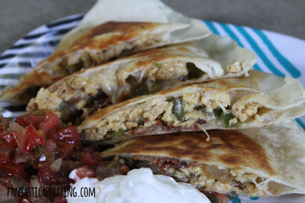 Breakfast Quesadillas // These quesadillas are packed with all the best breakfast foods and a bit of a kick with some jalapeno -- the perfect way to start the day! #recipe #breakfast #quesadillas #eggs #bacon