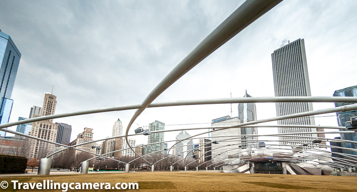 The center of Millennium Park is the Jay Pritzker Pavilion, a bandshell designed by Frank Gehry. The pavilion has 4,000 fixed seats, plus additional lawn seating for 7k the stage is framed by curving plates of stainless steel.