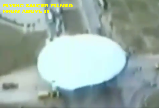 Flying saucer is filmed from above it showing how big it is.