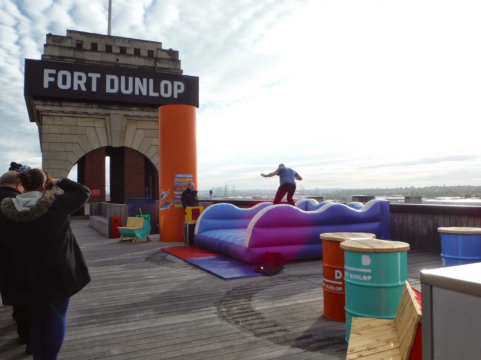 On the roof of Fort Dunlop. Chairs and tables can be seen across the roof, as can a surfboard ride