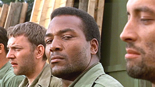 Jim Brown looking at the camera in The Dirty Dozen movieloversreviews.filminspector.com