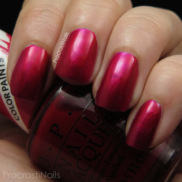 Swatch of OPI Magenta Muse which is a ruby pink jelly polish