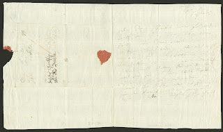 A handwritten letter with the remains of a red wax seal.