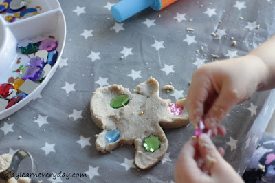 decorating a gingerbread play dough person