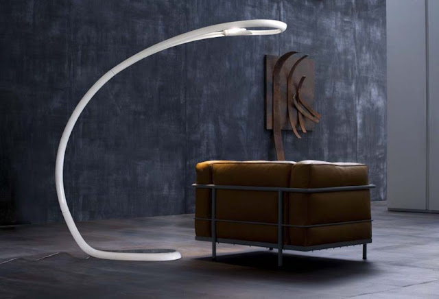 ultra modern white floor lamp ideas combined with ergonomic seating and wooden wall art