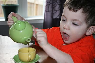 Toddler homeschool Montessori tea serving activity