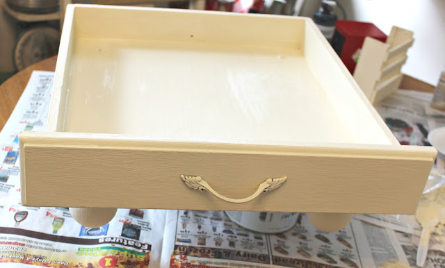 Photo of painting a drawer white