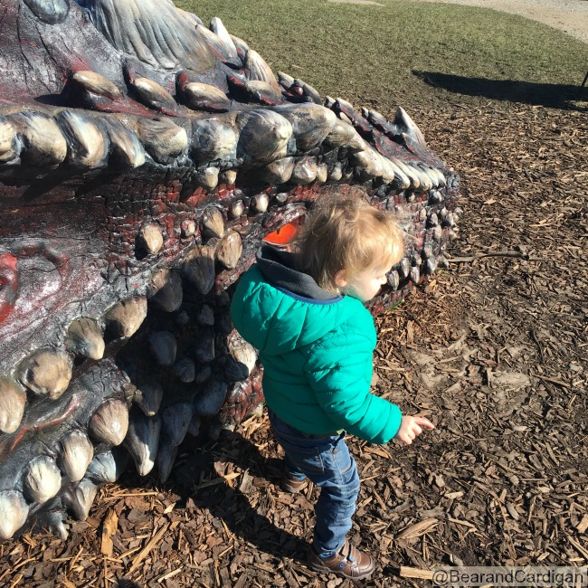 Caerphilly-Castle-with-toddler-standing-next-to-dragon
