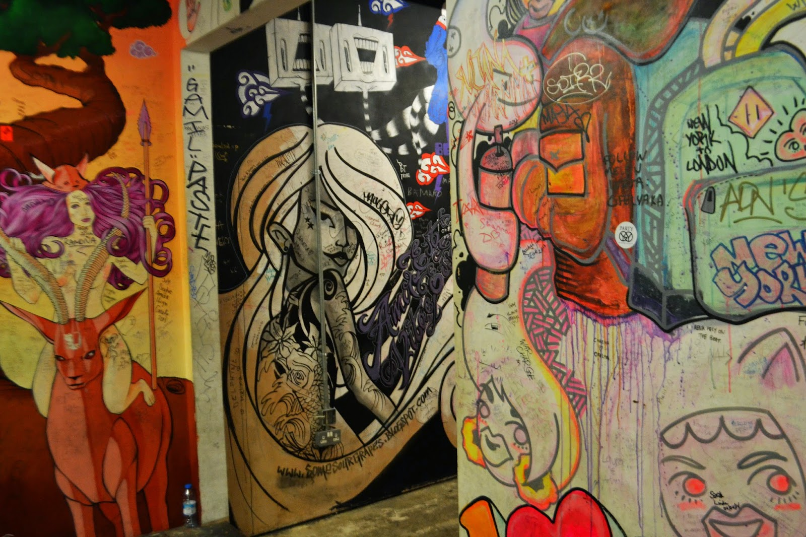 a heavily graffitied wall inside Camden Market