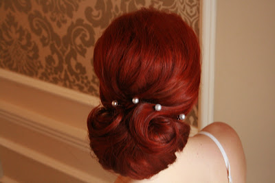 Red head bride with chignon and jewel detail