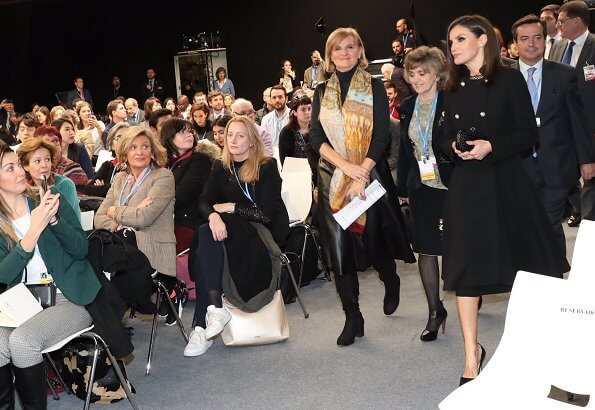 Queen Letizia carried Bottega Veneta black knot ntrecciato satin clutch and wore Magrit toe pumps at COP25 event
