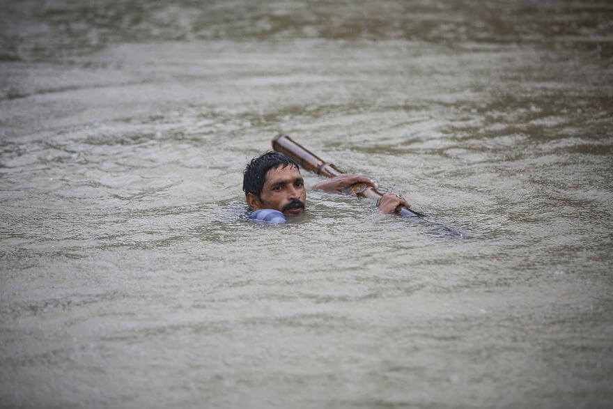18 Devastating Pictures Of The Flooding In South Asia That Will Shock You - A Nepali Man Tries To Cross Flood Water At Topa Village In Saptari District