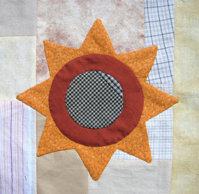 applique repair on scrap quilt