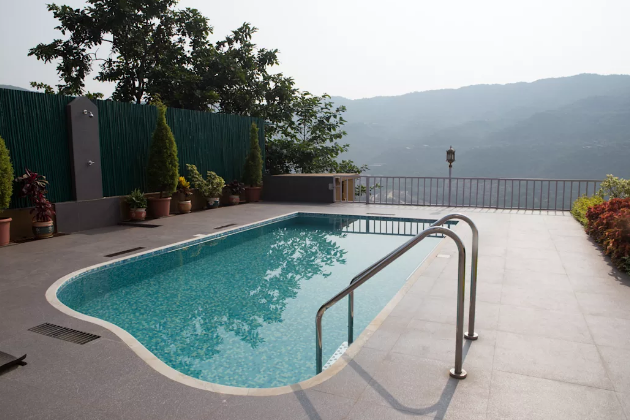 A Garden Pool with a beautiful hill view