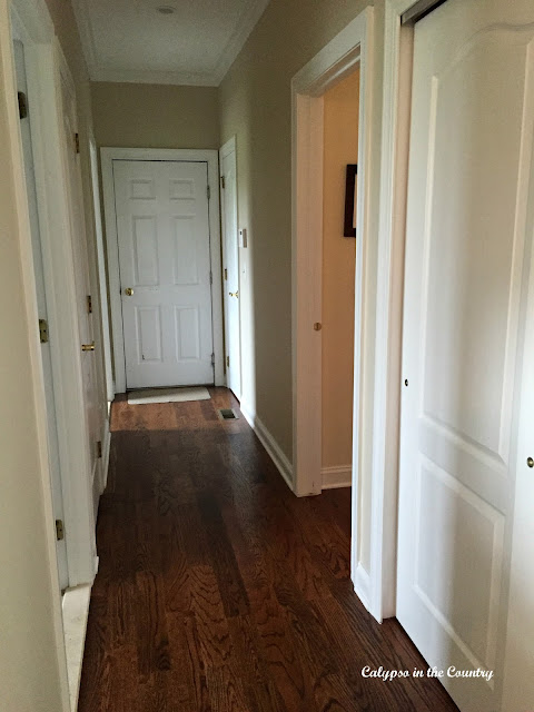Hallway with hardwood floors - red oak with Minwax Provincial Stain