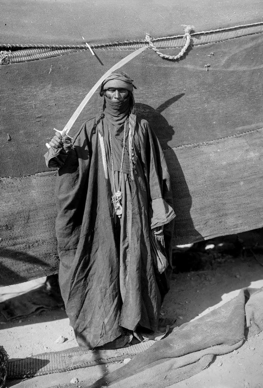 A Bedouin man showing his sword.