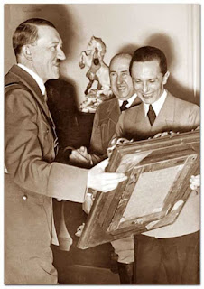 Adolf Hitler smiling with Dr. Goebbels worldwartwo.filminspector.com