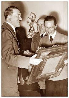 Adolf Hitler smiling with Dr. Goebbels worldwartwo.filminspector.com