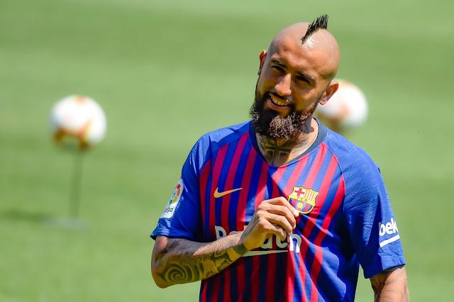 Barcelona unveils new signing Arturo Vidal