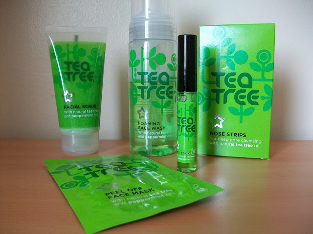 Superdrug ownbrand Tea Tree product range on a table.Including face masks, toner, moisturiser, facial scrub, nose pore strips, spot stick and exfoliator scrub