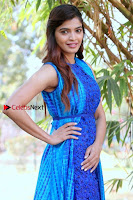 Tamil Actress Sanchita Shetty Latest Pos in Blue Dress at Yenda Thalaiyila Yenna Vekkala Audio Launch  0007.jpg