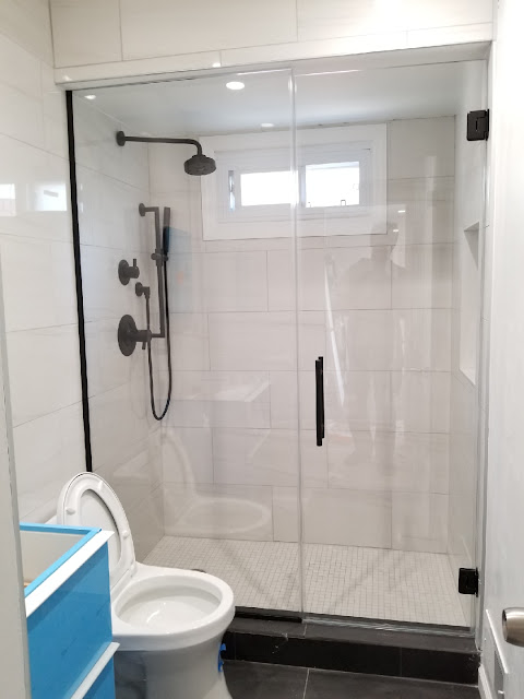 FRAMELESS GLASS SHOWER DOORS NYC
