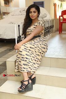 Telugu Actress Karunya Chowdary Stills in Short Dress at ATM Not Working Press Meet  0268.jpg